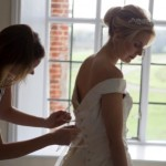Bride getting into dress Bruisyard
